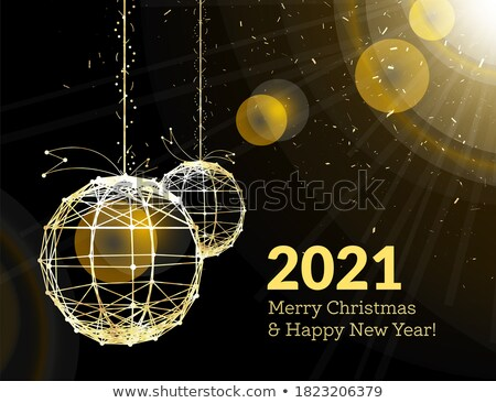New Year's Christmas balls, on luminous golden ribbons, in the style of art deco. Geometric golden s Stock photo © m_pavlov