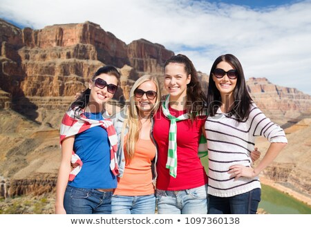 teenage girls or young women over grand canyon Stock photo © dolgachov