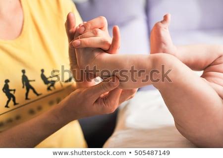 masseur doing massage for foot little baby Stock photo © ruslanshramko