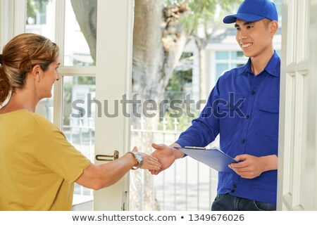 Technician Shaking Hands With Woman Stock photo © AndreyPopov
