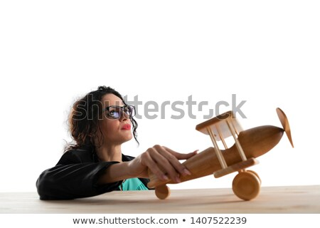 Businesswoman play with a toy aircraft. Concept of company startup and business success. Isolated on Stock photo © alphaspirit