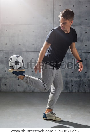 young man freestyle juggling soccer ball Stock photo © dolgachov