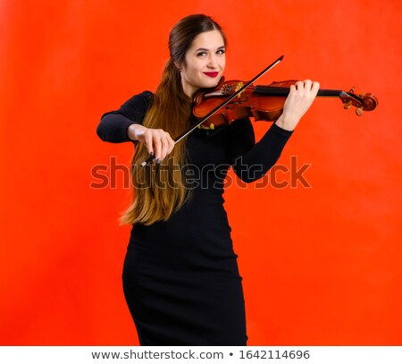 Kadın oynama keman müzik notaları örnek mutlu Stok fotoğraf © colematt