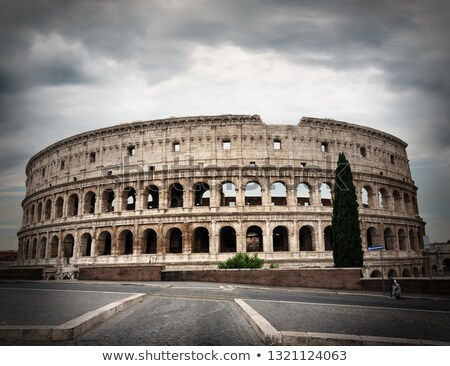 Gray clouds over Colosseum Stock photo © Givaga