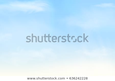 Natural frame from white clouds on a background of blue sky with sunbeams. Copy space. Stock photo © artjazz