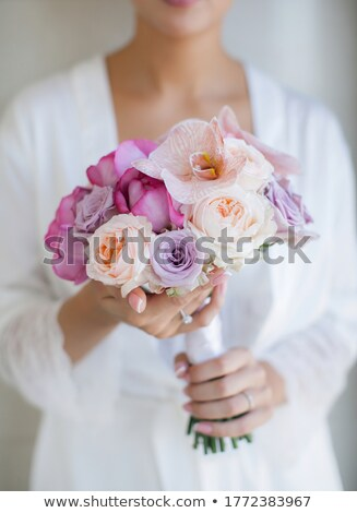 bride in a bathrobe holding her wedding bouquet stock photo © ruslanshramko