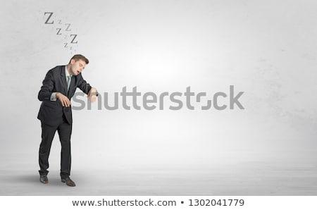 Businessman with sleeping sickness going somewhere Stock photo © ra2studio