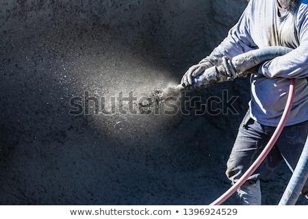 pool construction worker shooting concrete shotcrete or gunite stock photo © feverpitch