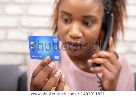 african woman with credit card using landline phone stock photo © andreypopov