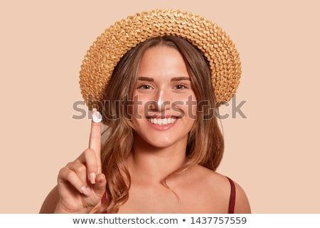 woman applying sunscreen lotion on her body stock photo © andreypopov