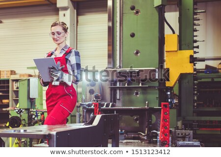 Woman worker with tablet computer in front of machine Stock photo © Kzenon