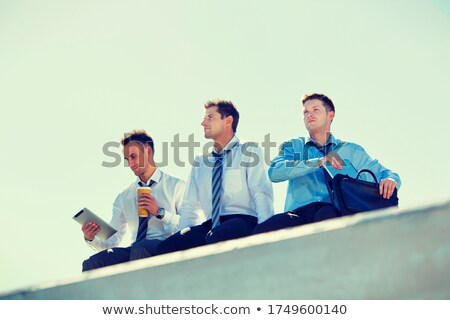Businessman outdoors contemplating. Stock photo © lichtmeister