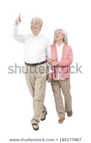 Vista lateral feliz casal de idosos de mãos dadas olhando câmera Foto stock © wavebreak_media