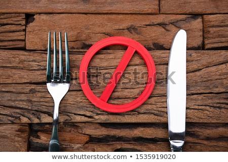 Dur işareti çatal bıçak ahşap masa imzalamak plaka Stok fotoğraf © AndreyPopov