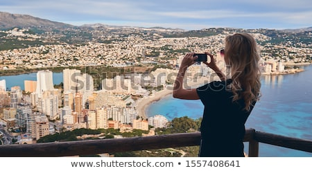 Young blond woman stands on fenced area climbed up on Penon de I Stock photo © amok