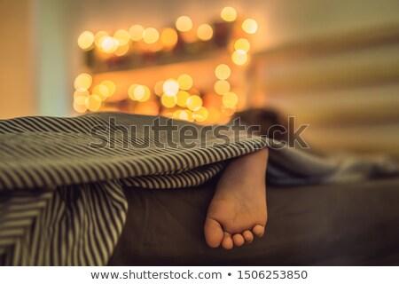 мальчика спальный кровать приход календаря представляет Сток-фото © galitskaya