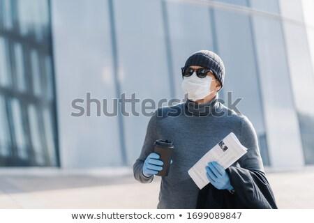 Horizontal shot of man being in danger to catch coronavirus in p Stock photo © vkstudio