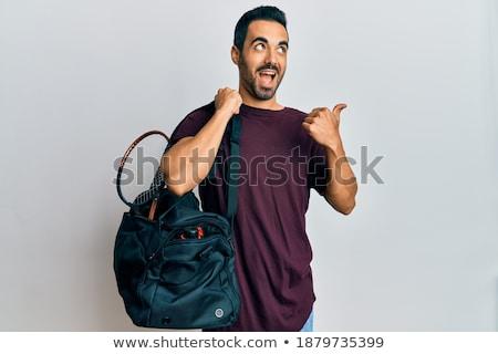 Optimista fiatalember tart táska felszerlés kép Stock fotó © deandrobot