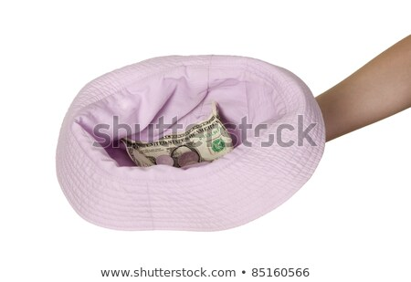 Dollars placed on cap which is held by man Stock photo © carenas1