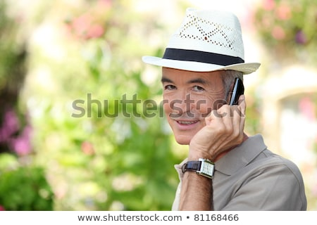 65 years old man wearing a straw hat and phoning stock photo © photography33