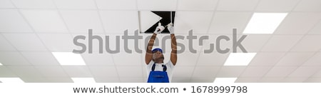 Man fixing ceiling light Stock photo © photography33
