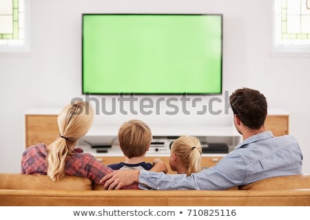 man relaxing on sofa watching television stock photo © photography33
