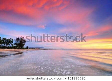 Stock photo: Calm ocean at sunrise