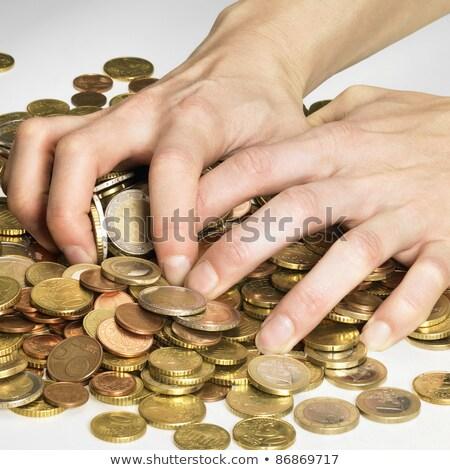 hand while gathering euro coins Stock photo © gewoldi