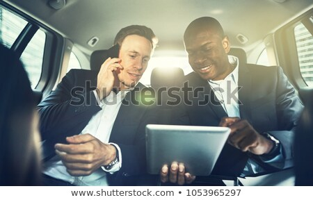 businessman using a cellphone in his car stock photo © photography33