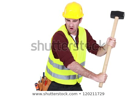 Tradesman hitting an object with a mallet Stock photo © photography33
