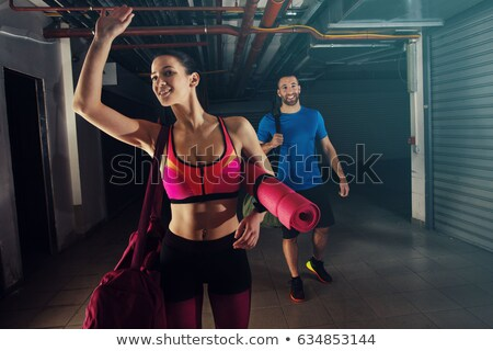 Woman with bag leaving gym Stock photo © photography33