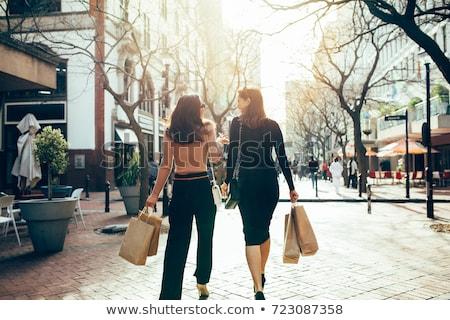 Winkelen stad jonge vrouw straat lopen jonge Stockfoto © val_th