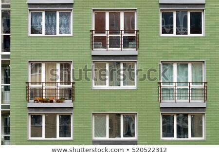 Egyedi társasház ablakok építészet kívül kilátás Stock fotó © eldadcarin