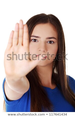 Stock photo: Confident woman making stop gesture sing with hand