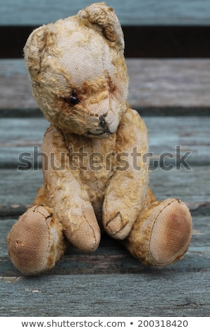 antique toys on wooden bench with vintage look stock photo © sandralise