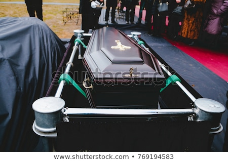 Funeral with coffin in hearse Stock photo © Kzenon