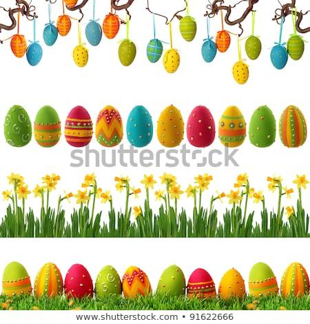 Handmade easter colored eggs hanging on the tree Stock photo © tannjuska
