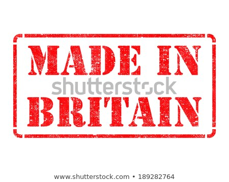 made in britain   inscription on red rubber stamp stock photo © tashatuvango