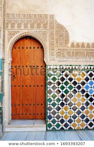 A wooden door in Alhambra palace stock photo © serpla