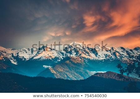 sunset over high mountain range stock photo © yongkiet