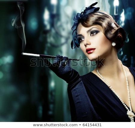 Portret młoda kobieta czarny hat palenia cygara Zdjęcia stock © courtyardpix