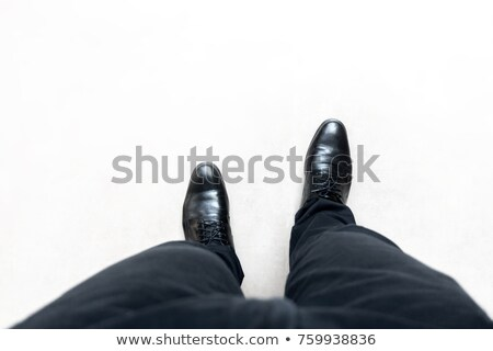 businessman with a foot on a step stock photo © ambro