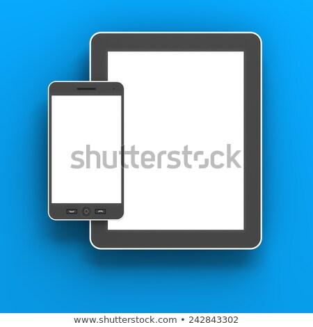 Generic Digital Tablet And Smartphone Against Blue Background Stok fotoğraf © ymgerman