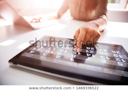 Midsection Of Businesswoman Holding Digital Tablet Stock photo © AndreyPopov