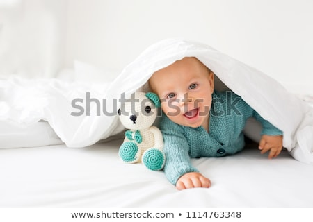 Cute baby with toy sitting on bed Stock photo © wavebreak_media