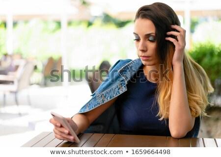 Problémák telefon egy nő fiatal nő portré kommunikáció Stock fotó © Giulio_Fornasar