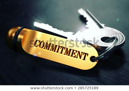 keys with word commitment on golden label stock photo © tashatuvango