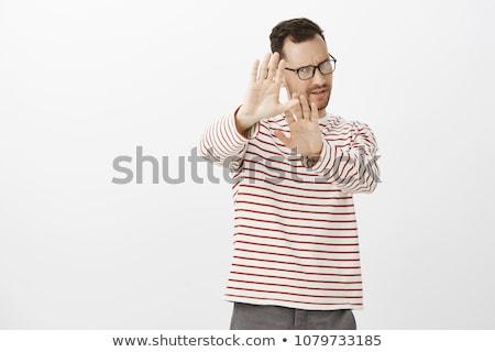 Ansioso empresário algo branco terno Foto stock © wavebreak_media