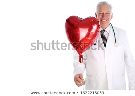 doctor with a heart-shaped balloon with the text world heart day Stock photo © nito