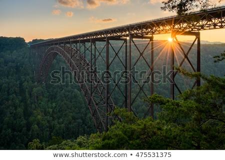 Novo rio ponte cênico céu nuvens Foto stock © alex_grichenko